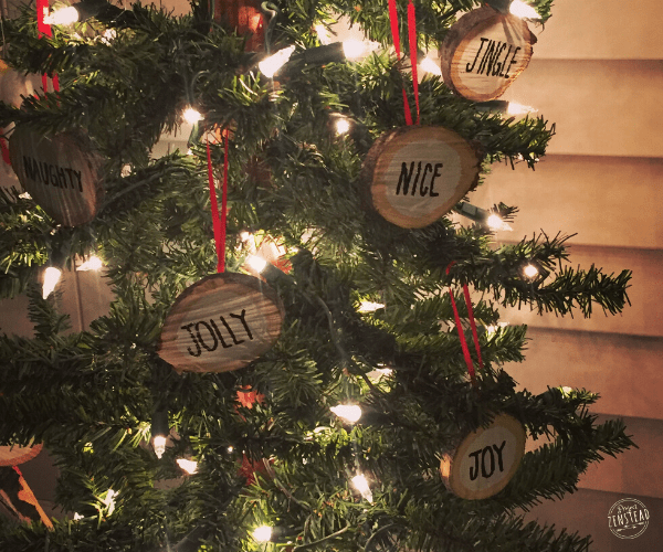 holiday tree decorated with wood slice ornaments and lights